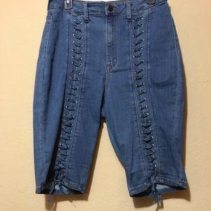Blue Fashion Nova lace up the front jean shorts